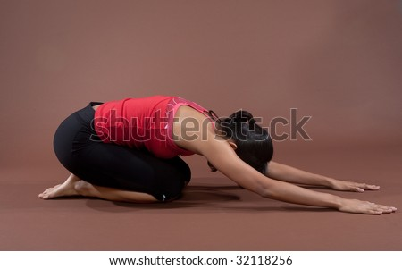 Young fitness woman doing stretching exercise as part of healthy lifestyle concept