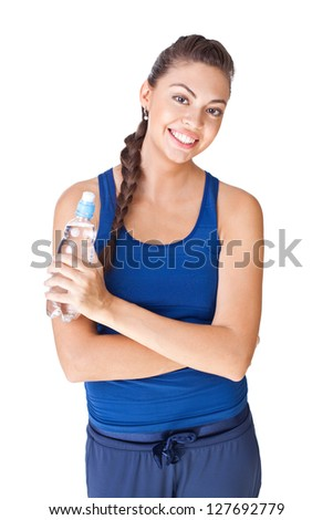 Young fitness woman holding bottle of water isolated on white background