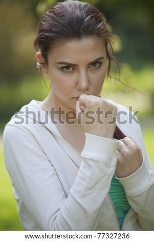 young fitness woman in fighting stance - stock photo