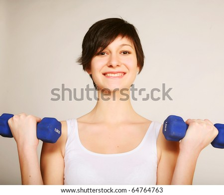 young fitness woman lifting weights