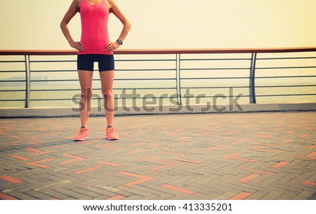 young fitness woman runner at seaside