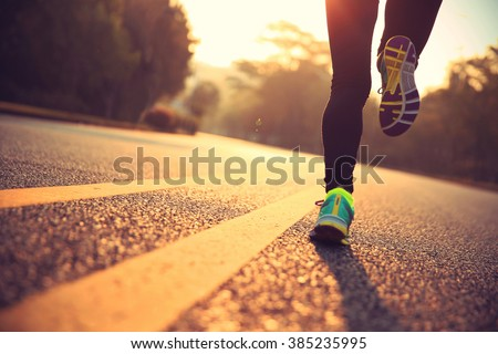 young fitness woman runner athlete running at road - stock photo