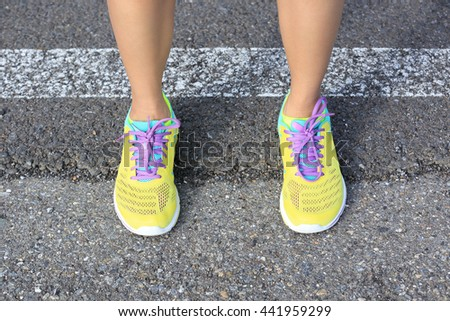 young fitness woman runner legs on road - stock photo