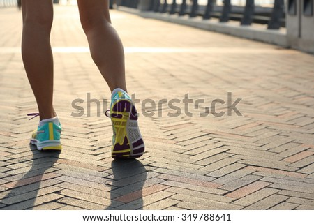 young fitness woman runner legs ready for a new start