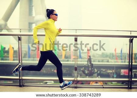 young fitness woman runner running at shanghai city - stock photo