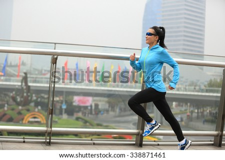 young fitness woman runner running at shanghai city