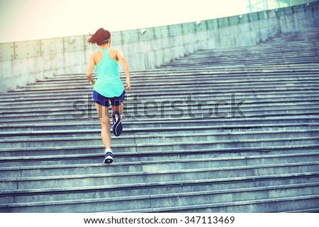 young fitness woman runner running on stairs - stock photo