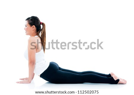 Young fitness woman stretched her body over  white background.