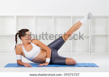 young fitness woman stretching - stock photo