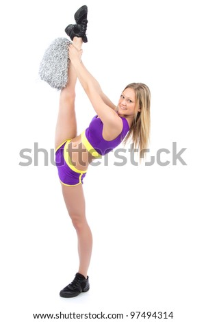 Young flexible cheerleader woman dancer in modern twine pose against white background
