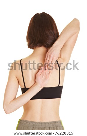 Young flexible woman touching her fingertips behind her back