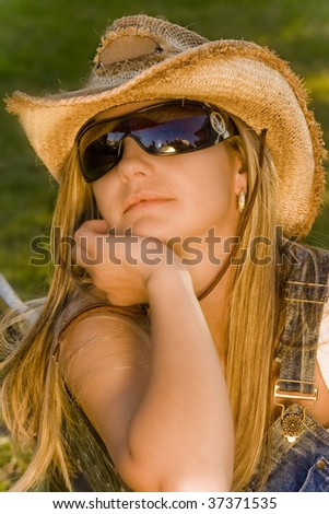 young flirty girl in a hat and sunglasses - stock photo