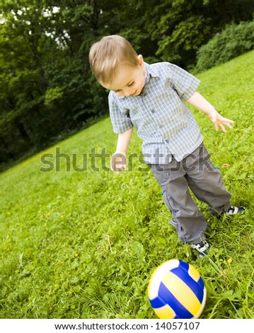 Young Football Player On  The Grass Field - stock photo