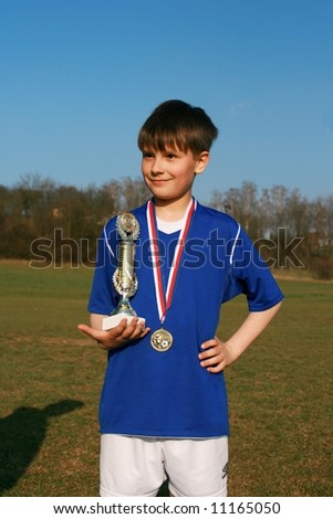 Young footballer is given credit for victory of match - stock photo
