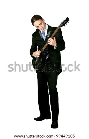 Young formal man playing on guitar isolated on white - stock photo