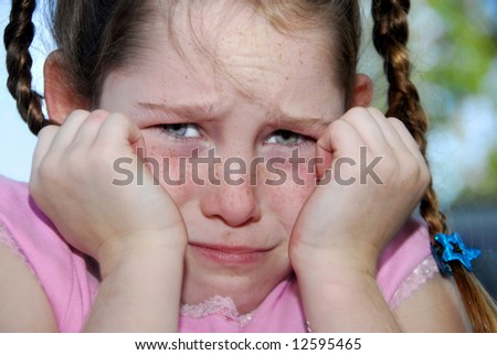Young freckle faced girl with braids looking frustrated or upset - stock photo