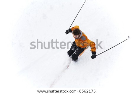 Young free rider in fresh powder snow; horizontal orientation, cloudy sky.