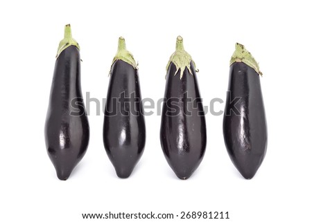 Young fresh black eggplants isolated on white - stock photo