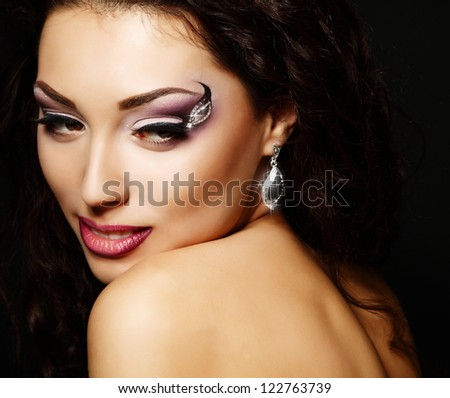 Young fresh luxury woman with beautiful makeup, beauty female portrait, face closeup over black