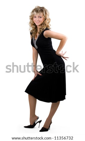 Young friendly blond woman in black dress on isolated background - stock photo