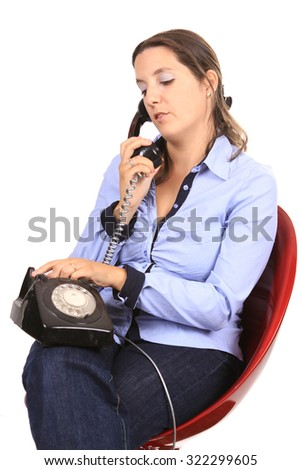 Young friendly brunette woman with headset smiling during conversation - stock photo