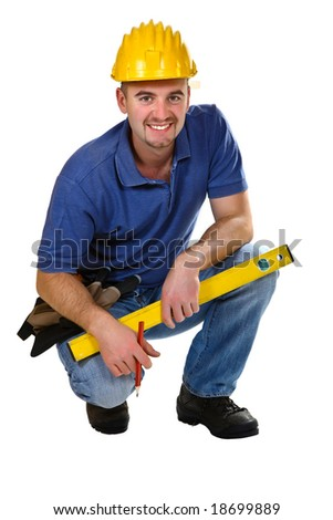 Young friendly crouch manual worker isolated on white - stock photo