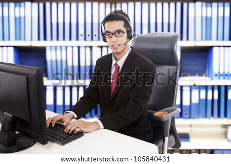 Young friendly customer service working at office - stock photo