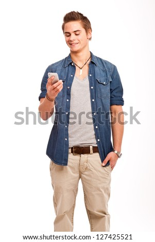 young, friendly guy checking his cellphone - stock photo