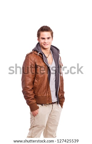 young, friendly guy in leatherjacket - stock photo