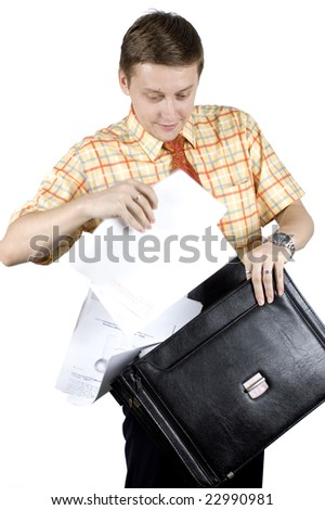 Young, friendly looking businessman holding briefcase with documents. Playing with briefcase, holding it and taking out documents.