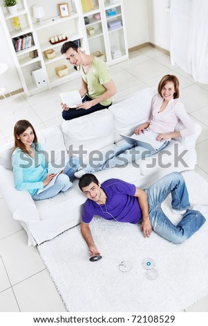 Young friends are engaged in a variety of activities - stock photo
