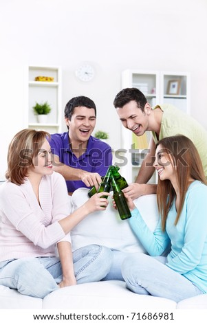 Young friends drinking beer - stock photo