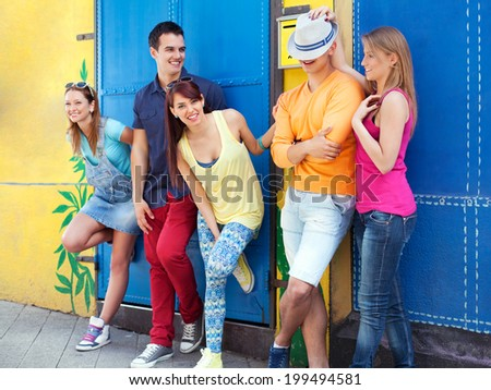 Young friends having fun in city - stock photo