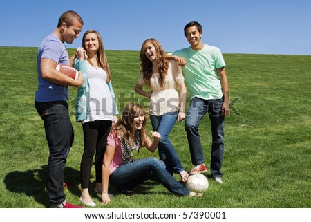 Young friends Having Fun together and playing sports - stock photo