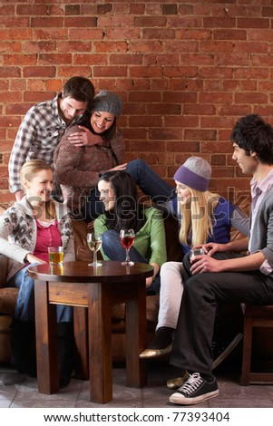 Young friends in caf - stock photo