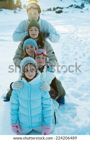 Young friends in snow, portrait - stock photo