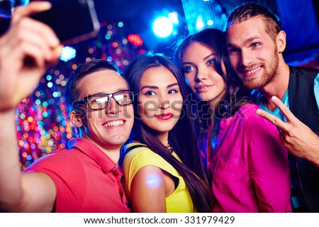 Young friends making selfie during party in nightclub - stock photo