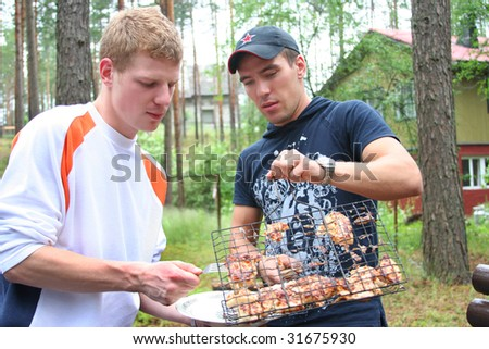 young friends on picnic - stock photo