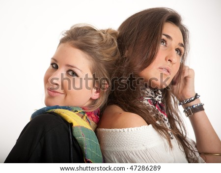 Young friends, one blonde, the other brunette with a dreaming expression - stock photo
