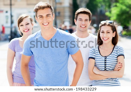 Young friends smiling  - stock photo