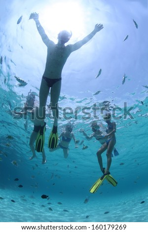 Young friends snorkeling in a tropical sea - stock photo