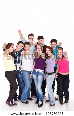 young friends standing and pointing their fingers at camera - stock photo