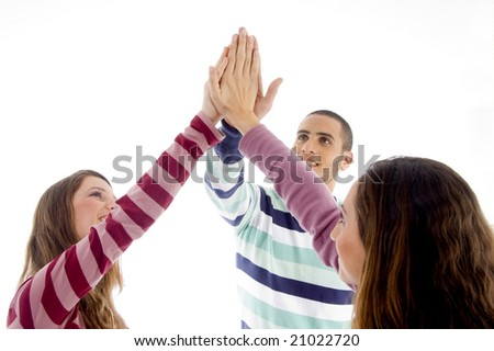 young friends with joined hands on an isolated background - stock photo