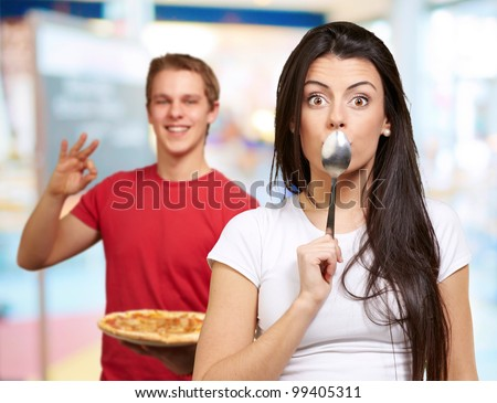 young friends with pizza doing good gesture - stock photo