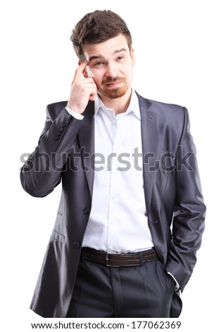 Young frustrated and stressed businessman, isolated on white background  - stock photo