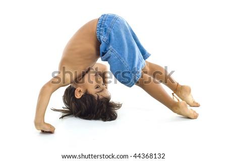 Young fun Boy doing gymnastics on white . - stock photo
