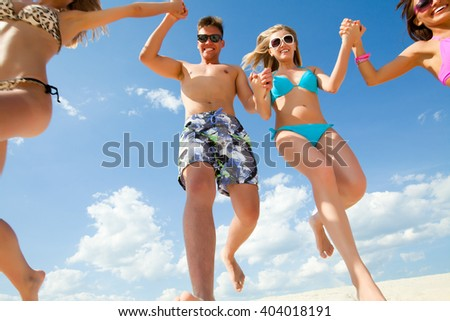 Young fun people enjoying summer on the beach