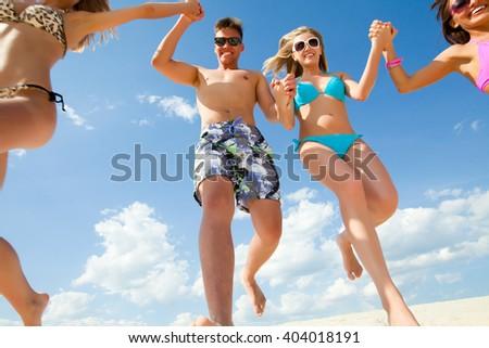 Young fun people enjoying summer on the beach - stock photo