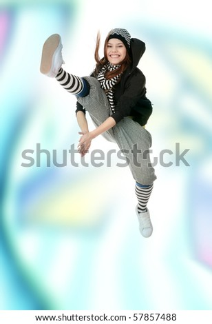 Young funky dancer against abstract graffiti background - stock photo