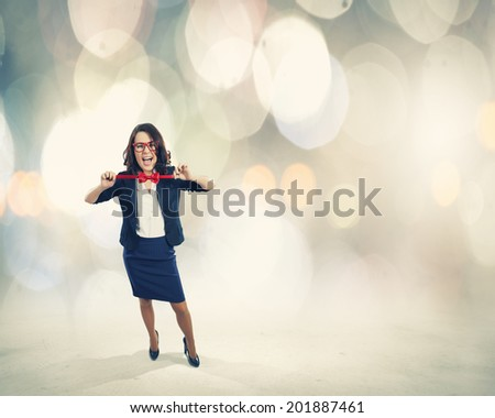 Young funny businesswoman in suit against bokeh background